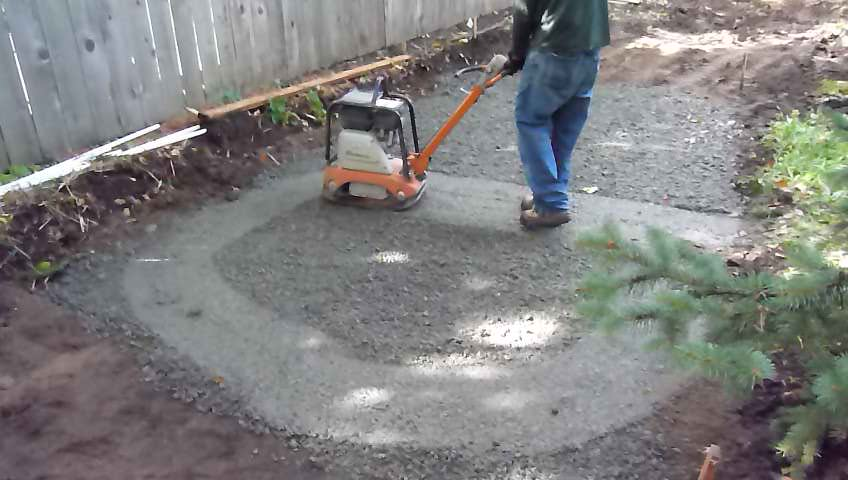 Leveling and compacting the pad